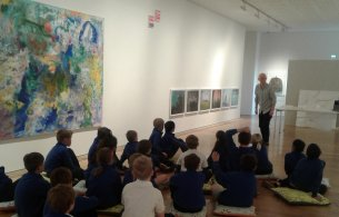 Curator Martin Drury previewing SurprEYES! exhibition with local school children