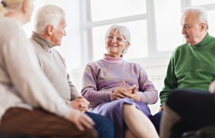 Stock image of older people talking