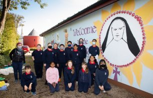 Mags Harnett and 6th class Dominican Primary School
