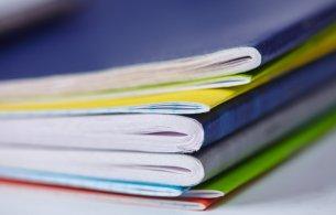 Pile of coloured leaflets