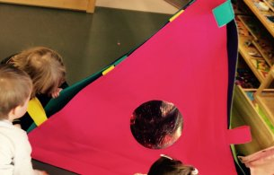 Children looking into a tetrahedron