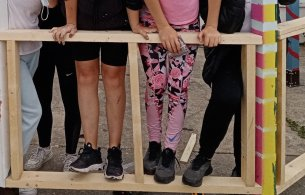 Image of young people testing strength of structure