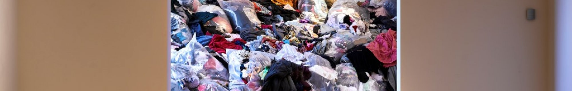 intsallation  by Catherine Delaney consisiting of a huge mound of second hand clothes in gallery 2, dlr LexIcon