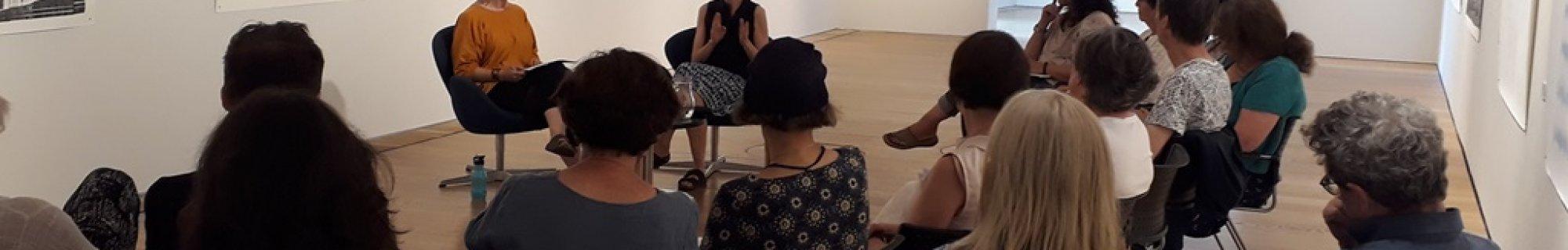Artist julie merriman discussing her artwork