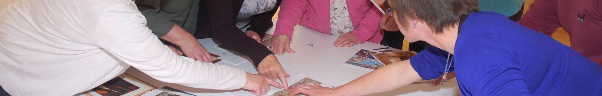 Image of group of people looking at pictures