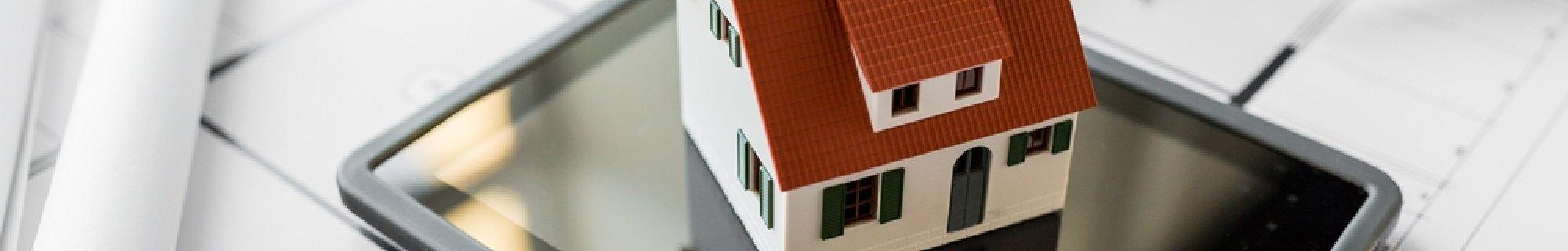 measuring tape, drawings, house model, ipad