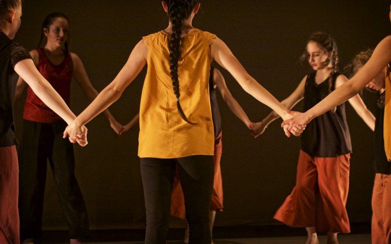 Dancers holding hands