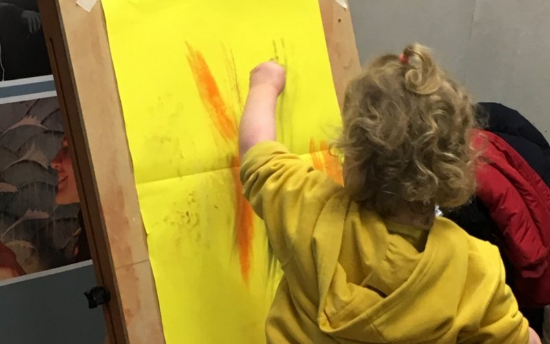 Child drawing at an easel