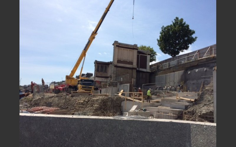 picture. the baths under construction with a crane