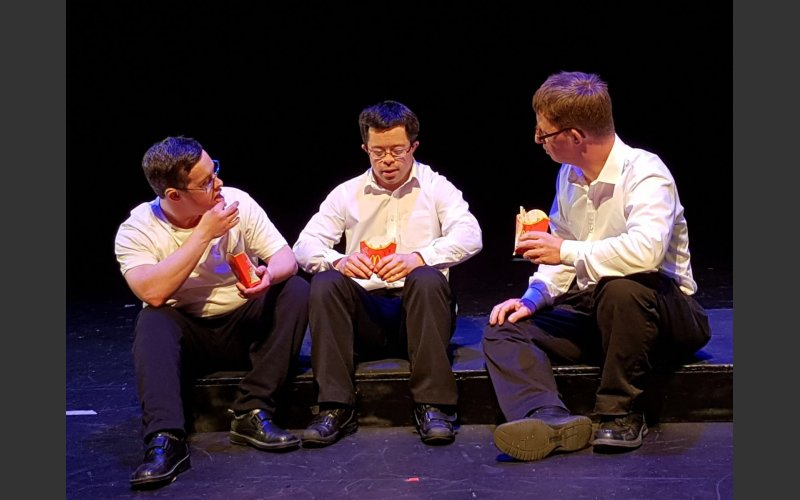 Picture of three performers from Loaded Dice Theatre Company