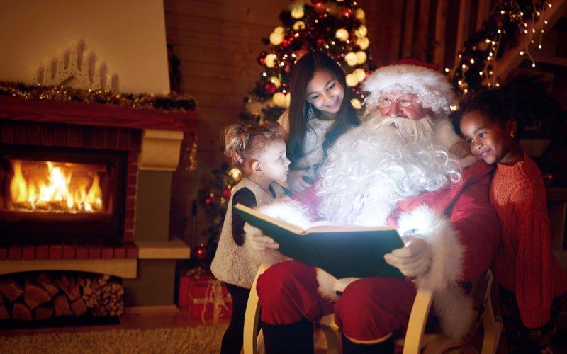 Image result for santa reading books