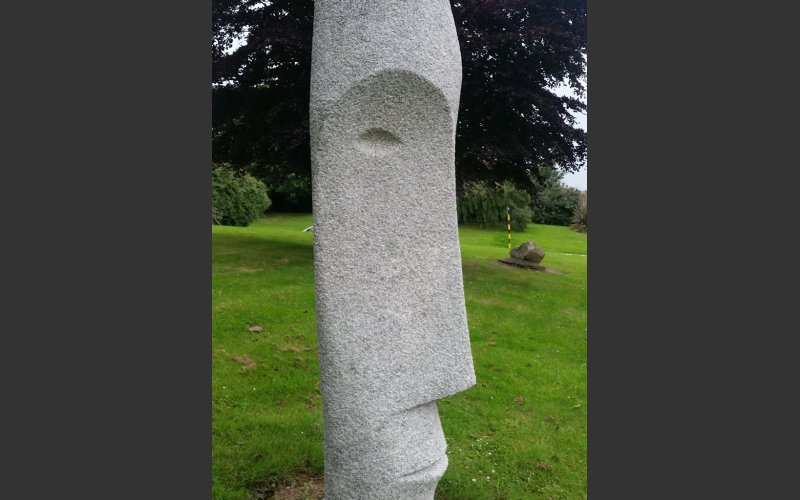 granite sculpture of an elongated head by thomas Glendon