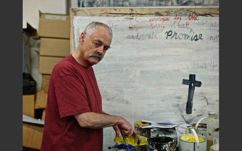 artist Patrick Graham painting in his studio