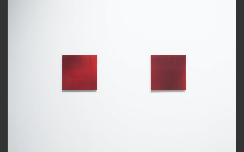 picture of two square red glass artworks