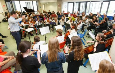 image of Newpark Concert Orchestra and young people from Newpark Music Centre